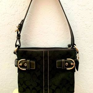 Coach leather and fabric shoulder handbag.
